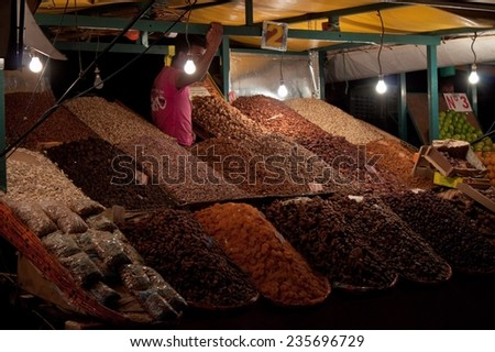 MARRAKESH, MOROCCO - AUG 7: Stalls with fruit at the Jema el Fna Square in Marrakesh on Aug 7, 2010 in Marrakesh, Morocco. The square is part of the UNESCO World Heritage. - stock photo