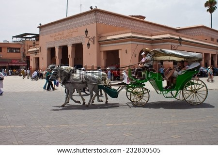 MARRAKESH, MOROCCO - AUGUST 8: Horse chariot at the Jema el Fna Square in Marrakesh on August 8, 2010 in Marrakesh, Morocco. The square is part of the UNESCO World Heritage. - stock photo
