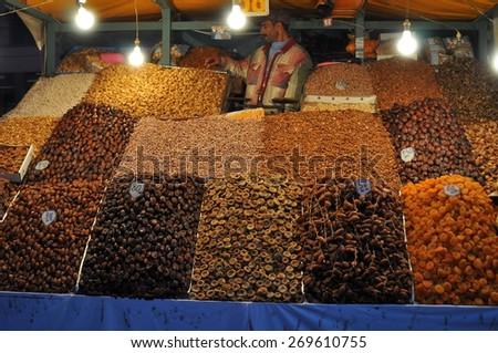 MARRAKESH, MOROCCO - Dec, 27: man trades a dried Fruits in Marrakesh Market on December, 27, 2009. MARRAKESH, MOROCCO - stock photo