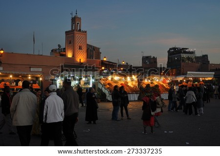 Marrakesh, Morocco - Dec, 27: Unidentified people visit the Jemaa el Fna Square at sunset on December, 27, 2009. Marrakesh, Morocco - stock photo