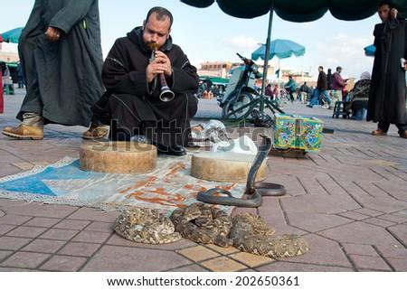 MARRAKESH, MOROCCO - JANUARY 27: Snake charmer at Djemaa el Fna square. January 27, 2010 in Marrakesh, Morocco - stock photo