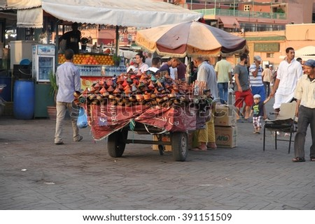 MARRAKESH, MOROCCO - JULY 11: A cart full of souvenirs in the Jemaa el Fna square in the old town of Marrakesh, Morocco on the 11th July, 2015. - stock photo