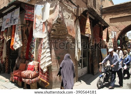 MARRAKESH, MOROCCO - JULY 11: A corner of an alleyway off the Jemaa el Fna square in the souks of the Old Town of Marrakesh, Morocco on the 11th July, 2016. - stock photo