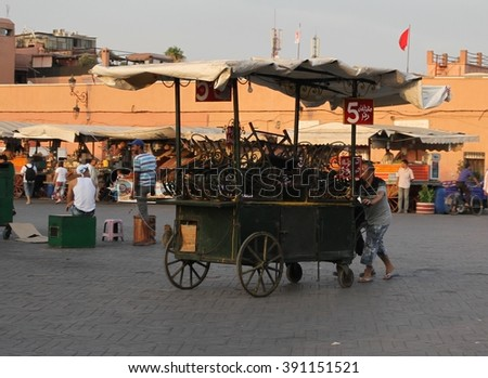 MARRAKESH, MOROCCO - JULY 11: A food cart sitting in the Jemaa el Fna square in the old town of Marrakesh, Morocco on the 11th July, 2015. - stock photo