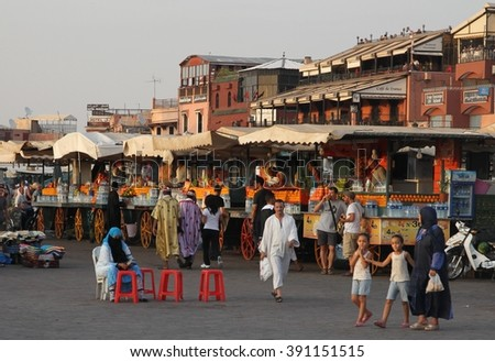 MARRAKESH, MOROCCO - JULY 11: A panoramic view in the late afternoon of the Jemaa el Fna square in the old town of Marrakesh, Morocco on the 11th July, 2015. - stock photo