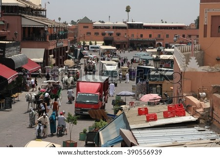 MARRAKESH, MOROCCO - JULY 11: A panoramic view of the Jemaa el Fna square of the Old Town of Marrakesh, Morocco on the 11th July, 2016. - stock photo