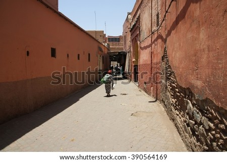MARRAKESH, MOROCCO - JULY 11: An alleyway near the Jemaa el Fna square of the Old Town of Marrakesh, Morocco on the 11th July, 2016. - stock photo