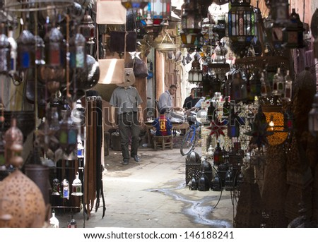 MARRAKESH ,MOROCCO - JUNE 4: Unidentified people at a market street in Marrakesh on June 4, 2013 in Marrakesh. In 2009 the medina got part of UNESCO World Heritage. - stock photo