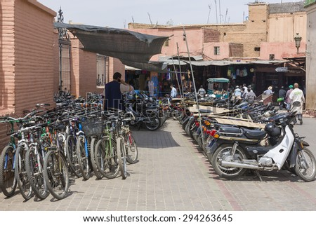 MARRAKESH ,MOROCCO - JUNE 4: Unidentified people at a street in Marrakesh on June 4, 2013 in Morocco. With a population of over 900,000 inhabitants it is the most important city in Morocco. - stock photo