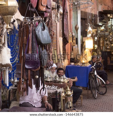 MARRAKESH ,MOROCCO - JUNE 4: Unidentified people in the souk of Marrakesh on June 4, 2013 in Marrakesh. In 2009 the medina got part of UNESCO World Heritage. - stock photo