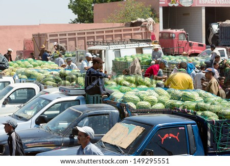 MARRAKESH ,MOROCCO - JUNE 4: Unidentified people selling water melon in a souk of Marrakesh on June 4, 2013 in Morocco. In 2009 the medina got part of UNESCO World Heritage.  - stock photo
