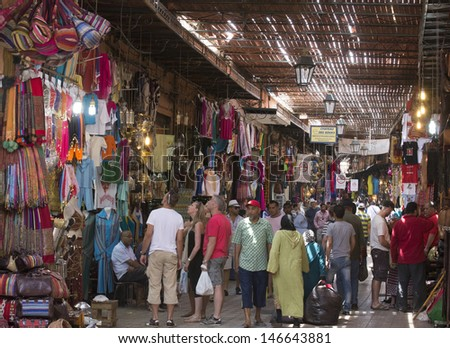 MARRAKESH ,MOROCCO - JUNE 4: Unidentified people shopping in the souk of Marrakesh on June 4, 2013 in Marrakesh. In 2009 the medina got part of UNESCO World Heritage. - stock photo
