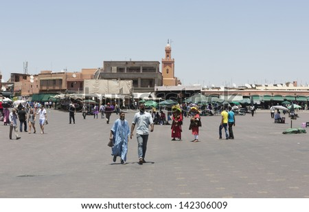 MARRAKESH, MOROCCO - JUNE 3: Unidentified people visit the Jemaa el Fna Square on June 3, 2013 in Marrakesh, Morocco. The square is part of the UNESCO World Heritage. - stock photo