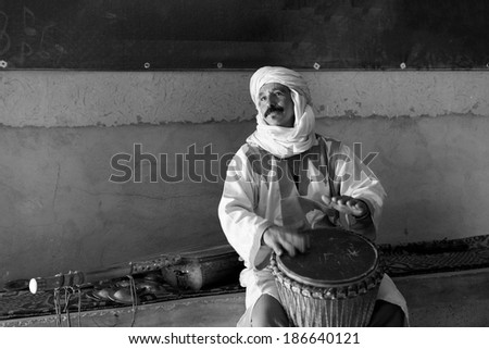 MARRAKESH, MOROCCO - MARCH 3: A man sings in house of Marrakesh on March 3, 2014. This musician tries to make some money singing, to survive in Morocco's harsh economy.