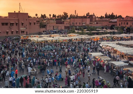 MARRAKESH, MOROCCO - MAY 25, 2014: Sunset over Jamaa el Fna (also Jemaa el-Fnaa, Djema el-Fna or Djemaa el-Fnaa) square and market place in medina quarter. During the night it�´s full of food-stalls - stock photo