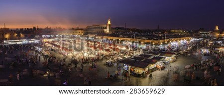 MARRAKESH, MOROCCO - MAY 11-2015: Unidentified crowd on the Jemaa el Fna Square during the sunset on May 11, 2015 in  Marrakesh, Morocco. The square is declared UNESCO World Heritage Site.  - stock photo