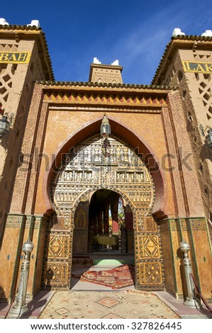 MARRAKESH, MOROCCO, NOV 17: Entrance to the Kasbah, famous lodging in Marrakesh, blue clear sky in the background. Morocco 2010 - stock photo