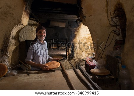 MARRAKESH ,MOROCCO - NOVEMBER 12: Unidentified man making traditional bread in Marrakesh on November 12, 2015 in Morocco. Marrakech it is the most important city in Morocco.  - stock photo