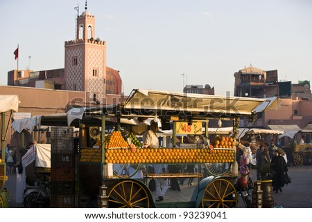 MARRAKESH, MOROCCO - NOVEMBER 3: Unidentified people visit the Jema el Fna Square in Mararkech on November 3, 2007 in Marrakesh, Morocco. The square is part of the UNESCO World Heritage. - stock photo