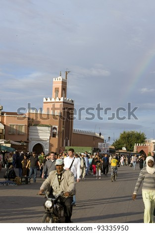 MARRAKESH, MOROCCO - NOVEMBER 3: Unidentified people visit the Jema el Fna Square in Marrakesh on November 3, 2007 in Marrakesh, Morocco. The square is part of the UNESCO World Heritage. - stock photo