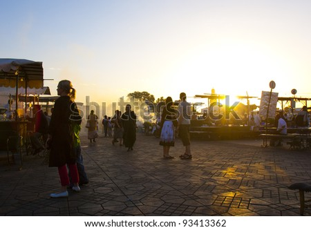 MARRAKESH, MOROCCO - NOVEMBER 3: Unidentified people visit the Jemaa el Fna Square on November 3, 2007 in Marrakesh, Morocco. The square is part of the UNESCO World Heritage. - stock photo