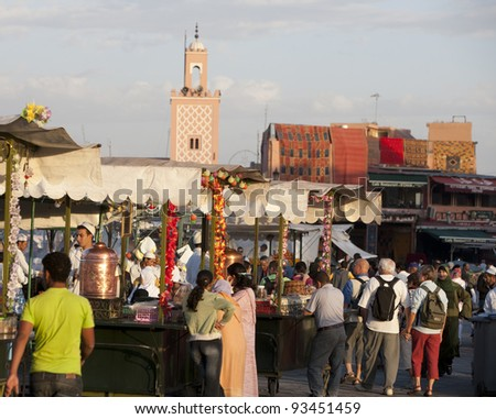 MARRAKESH, MOROCCO - NOVEMBER 3: Unidentified people visit the Jemaa el Fna Square on November 3, 2007 in Marrakesh, Morocco. The square is part of the UNESCO World Heritage. - stock photo