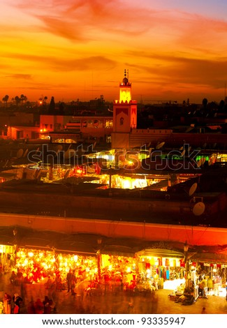 MARRAKESH, MOROCCO - NOVEMBER 3: Unidentified people watching the sunset on the Jema el Fna Square on November 3, 2007 in Marrakesh, Morocco. The square is part of the UNESCO World Heritage. - stock photo