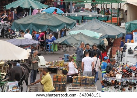 MARRAKESH, MOROCCO - OCTOBER 8: A panoramic view of the bustling scene of the Jemaa el Fnaa Square, Marrakesh, Morocco on the 8th October, 2015. - stock photo