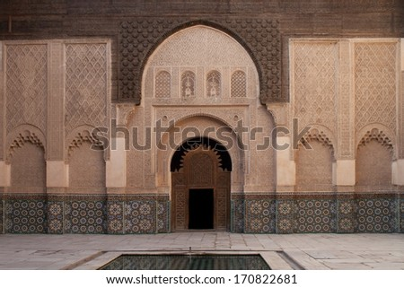 MARRAKESH, MOROCCO - OCTOBER 20, 2007. Courtyard of Ben Youssef Madrassa. Decorated with mosaic, wood carving and stone carving. Islamic school. Late 16th century. Marrakesh, Morocco.