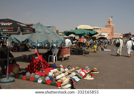 MARRAKESH, MOROCCO - OCTOBER 7: Hawkers, touts and tourists in the Jemaa El Fna square of Marrakesh, Morocco on the 7th October, 2015. - stock photo