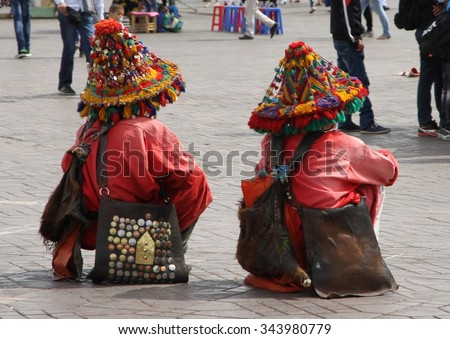 MARRAKESH, MOROCCO - OCTOBER 8: Traditionally dressed musicians in the middle of the Jemaa el-Fnaa square of Marrakesh, Morocco on the 8th October, 2015. - stock photo