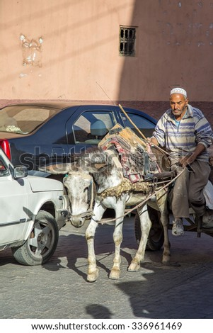 MARRAKESH, MOROCCO - SEPTEMBER 11, 2015: Unidentified man on the street of Marrakesh, Morocco. Marrakesh is the fourth largest city in Morocco. - stock photo