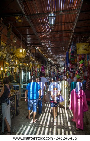 MARRAKESH, MOROCCO - SEPTEMBER 13, 2014: Unidentified people at souk in Marrakesh, Morocco. Marrakesh has the largest traditional Berber market (souk) in Morocco. - stock photo