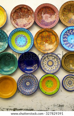MARRAKESH, MOROCCO, SEPTEMBER 13: Various colored food plates hanging on the wall at the souk of Marrakesh. Morocco 2006