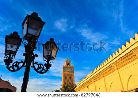 Marrakesh, Morocco:  Street lamp and exterior mosque wall with minaret Marrakesh, Morocco.
