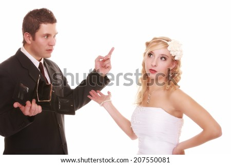 Marriage and money concept of high wedding cost. Angry groom with empty purse bride looking surprised. Bad relationship conflict quarrel isolated - stock photo