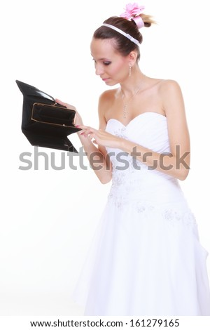 Marriage and money concept of high wedding cost. Bride with empty purse looking surprised isolated - stock photo