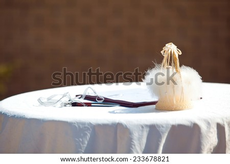 Marriage certificate and wedding rings at the altar - stock photo