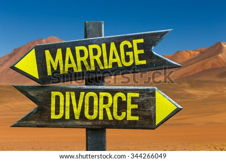 Marriage - Divorce signpost in a desert background - stock photo