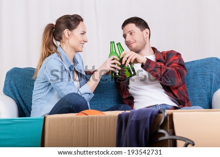 Marriage having a break in packing stuff - stock photo