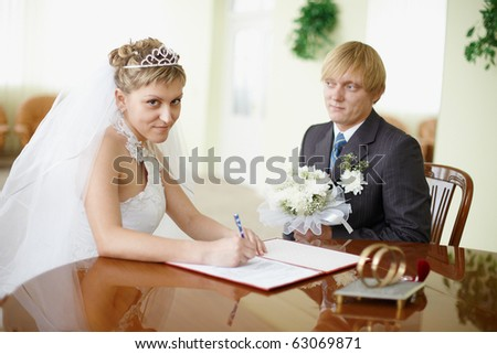 Marriage registration in a solemn hall - signature - stock photo