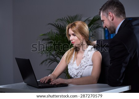 Married boss cheating wife with young beauty secretary - stock photo