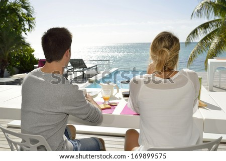 Married couple enjoying breakfast in luxury hotel  - stock photo