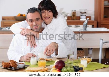 married couple having breakfast - stock photo