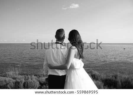 married couple in a beautiful landscape