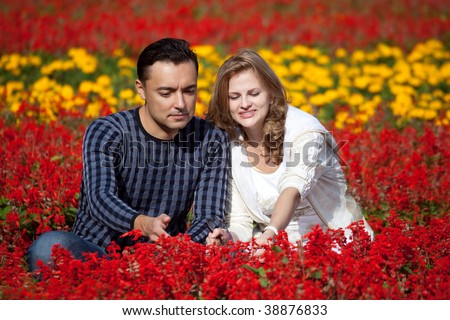 married couple in flowering park - stock photo