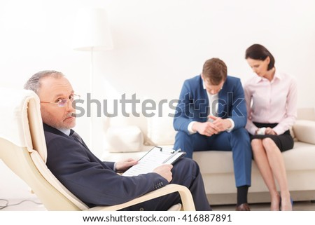 Married couple is consulting a psychotherapist - stock photo