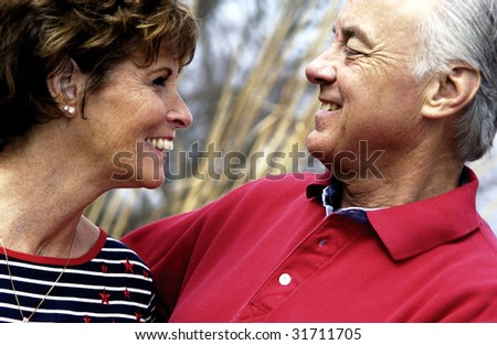 Married Couple smiling at each other - stock photo
