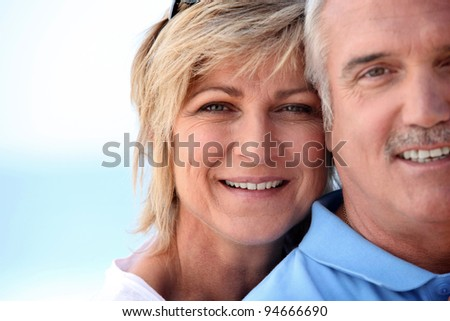 Married couple stood on a beach - stock photo
