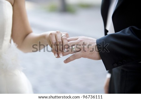 Married couples hands close up - stock photo
